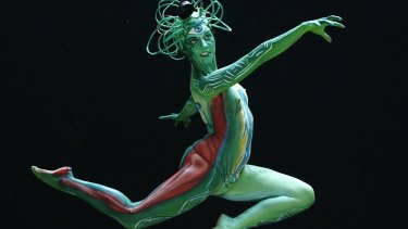 A model leaps at the annual World Bodypainting Festival in Poertschach.