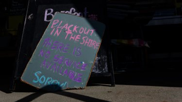 """Blackout in the shire"": One restaurant posted this sign after wild winds cut power to thousands of homes and businesses."