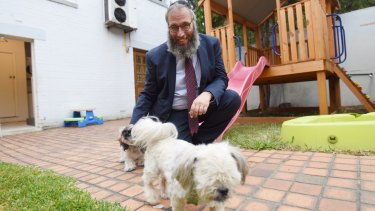 Rabbi Mendel Kastel with two dogs at Jewish House. The crisis centre is one of the only places people in crisis can also bring their pets.