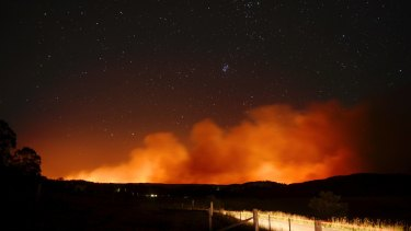 A massive bushfire near Putty was threatening properties on Wednesday.