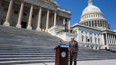 Senate Minority leader Harry Reid on the steps of the Capitol.