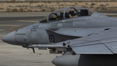 A Royal Australian Air Force F/A-18F Super Hornet taxis to begin another mission in the Middle East.