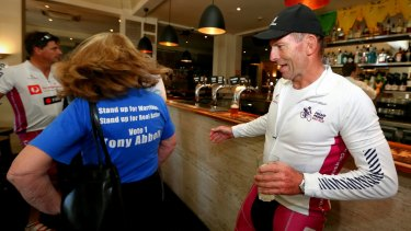 "Ms Aiken wearing her ""Vote 1 Tony Abbott"" t-shirt."