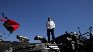 Production designer Colin Gibson atop the War Rig from Mad Max: Fury Road.