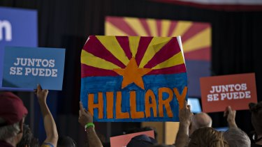 Attendees hold signs while waiting for Tim Kaine, 2016 Democratic vice presidential nominee in Phoenix, Arizona.
