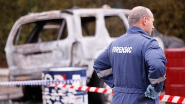 Forensic investigators inspect a car allegedly used in a police shooting in Moonee Ponds on July 7, 2015.