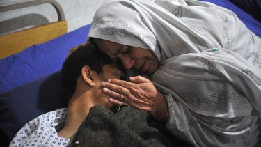 A mother with her son, who was injured in the attack.