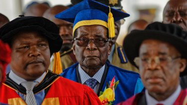 Zimbabwe's President Robert Mugabe, centre, made his first public appearance on Friday, since his house arrest.