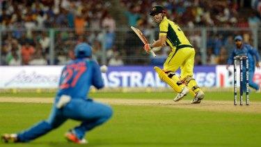 India's Ajinka Rahane takes a catch to dismiss David Warner.