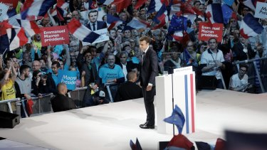 French presidential candidate Emmanuel Macron delivers a speech during a campaign rally at Bercy Arena.
