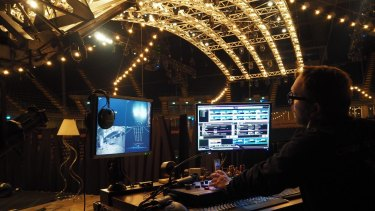 """Assistant head of automation Christian """"Pedro"""" Segura operates the téléphérique from 'the garage' mezzanine above the stage hidden from the audience's view at Impact Arena, Bangkok."""