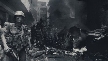 A military policeman at the scene of a car bomb explosion in East Beirut in May 1986.
