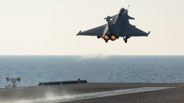 A French army Rafale fighter jet taking off from the deck of France's aircraft carrier Charles De Gaulle last year. French jets bombed Islamic State targets in the Iraqi cities of Ramadi and Mosul.