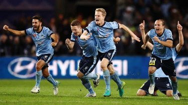 Ecstatic: Sydney FC players celebrate winning the grand final penalty shootout.