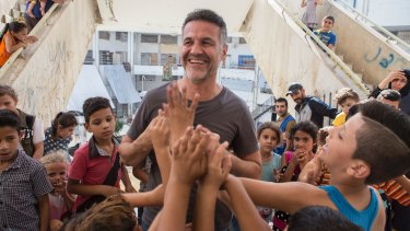 Hosseini meets Syrian refugee families at the Waha Collective Shelter at  Deddeh in northern Lebanon.