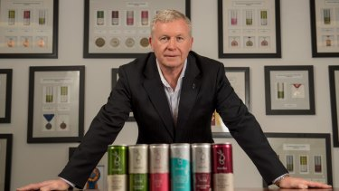 Greg Stokes, chairman and chief executive of Barokes Wines in their Tullamarine offices and warehouse. Some of Barokes Wines many medals are on the wall.