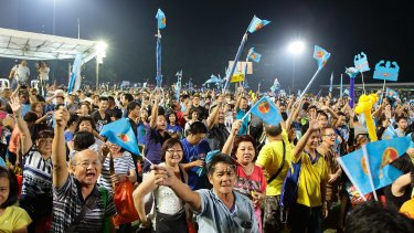 Worker's Party supporters at a night rally in Singapore on Wednesday.