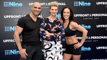 <i>Australian Ninja Warrior</i> host Rebecca Maddern with contestants, husband and wife team Zac and Amanda.