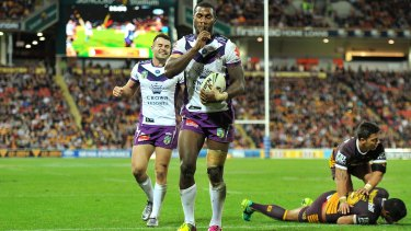 Listen up: Suliasi Vunivalu leaves Broncos in his wake in a dominant night for the Storm wingers.