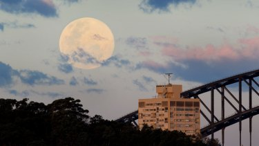 A supermoon rises over Sydney Harbour Bridge in 2014.