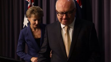 Attorney-General George Brandis and the Minister Assisting the Prime Minister for Women Michaelia Cash announcing the cuts reversal on Thursday.