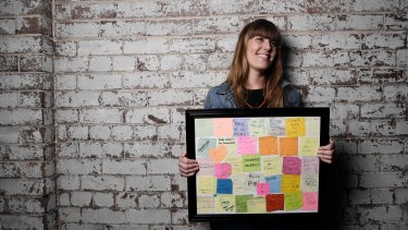 Artist Laura Sullivan and some of the notes she has found on the streets over the past 12 years.