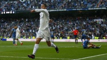 That's the way he likes it: Cristiano Ronaldo celebrates scoring Real Madrid's fourth goal against Getafe.