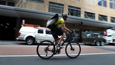 A cyclist on Castlereagh Street in the city.