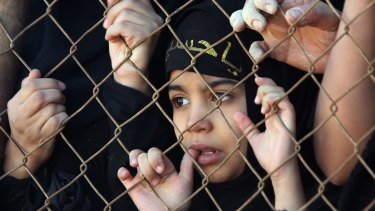 An Iraqi Shiite girl watches a re-enactment of the Battle of Karbala as part of the Ashura commemorations in the capital Baghdad.