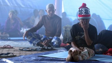 Villagers sit in a temporary shelter in Bali.