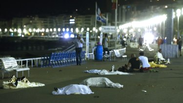 Bodies are seen on the ground after at least 84 people were killed in Nice.