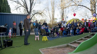 ACT Greens minister Shane Rattenbury speaks to the crowd at the Manuka Occasional Childcare Centre on Sunday.