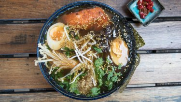 Chilli and coriander ramen with salmon, egg, shallots, nori and mushrooms.