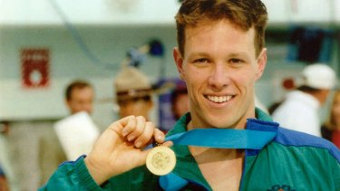 Kieren Perkins with his gold medal from the 1994 Commonwealth Games.