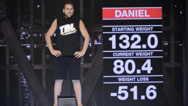 Daniel Jofre stands on the scale on The Biggest Loser: Families finale.