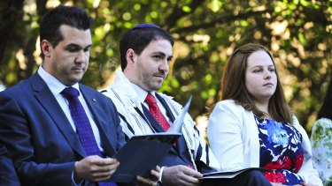 Celebration: MP Michael Sukkar and Rabbi Alon Meltzer and his wife, Linsay, at the inauguration in Canberra.