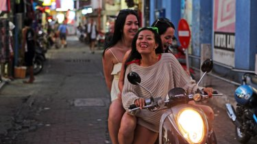 Street run in Bali: 10 per cent of Australians travelling overseas in 2015-16 rode a motorcycle or moped during their travels, a survey shows.