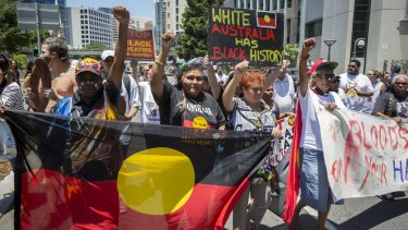 Demonstrators gather to protest the deaths of indigenous Australians in custody.