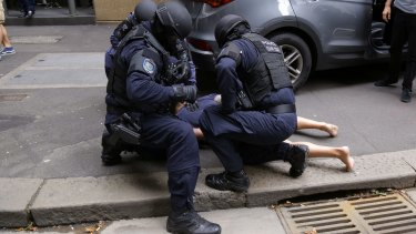 A man is arrested on O'Connell Street as part of the operation.