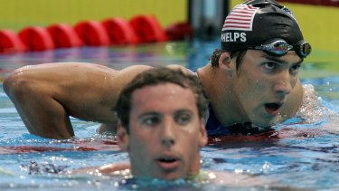 Friend or foe: Long term rivals in the pool, Michael Phelps and Grant Hackett have a lot to do with each other in private.