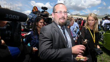 Senator Ricky Muir takes a pie for a walk outside Parliament House.