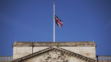 A Union flag flies at half-mast on Buckingham Palace in London, to mark an official day of mourning a week since the deadly Tunisia beach attack.