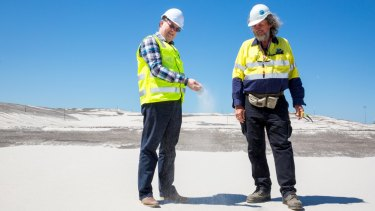 Brisbane's New Parallel Runway project director Paul Coughlan (left) with works inspector Des Hasemann on top of 11 million cubic metres of sand that is ready to become Brisbane's new runway.
