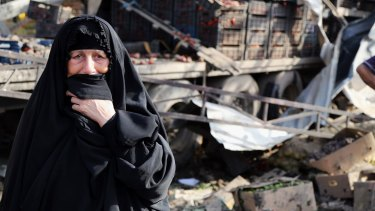 An Iraqi woman grieves at the scene of the bomb attack.