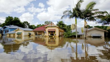 Weather events, such as the 2011 floods in Brisbane, pictured, have not had a large impact on bank losses. But a new report argues these risks will increase over time.