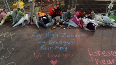 Messages written at the Swanston Street site where Alexander and Bridget Jones were killed by a falling wall.