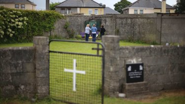 Members of the public gather in memory of the children buried here at the site of a mass grave for babies who died in the Tuam mother and baby home in Ireland.