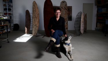 Artist and author Kim Mahood with her dog Pirate in her studio near Canberra.