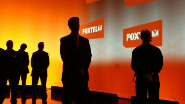 Foxtel reached a record 2.8 million subscribers in the year ended June, but full-year profit slid 8 per cent after it slashed prices and launched streaming and broadband services.