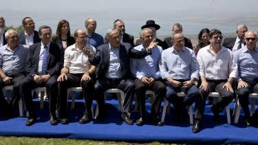 Mr Netanyahu with his ministers on the occupied Golan Heights.